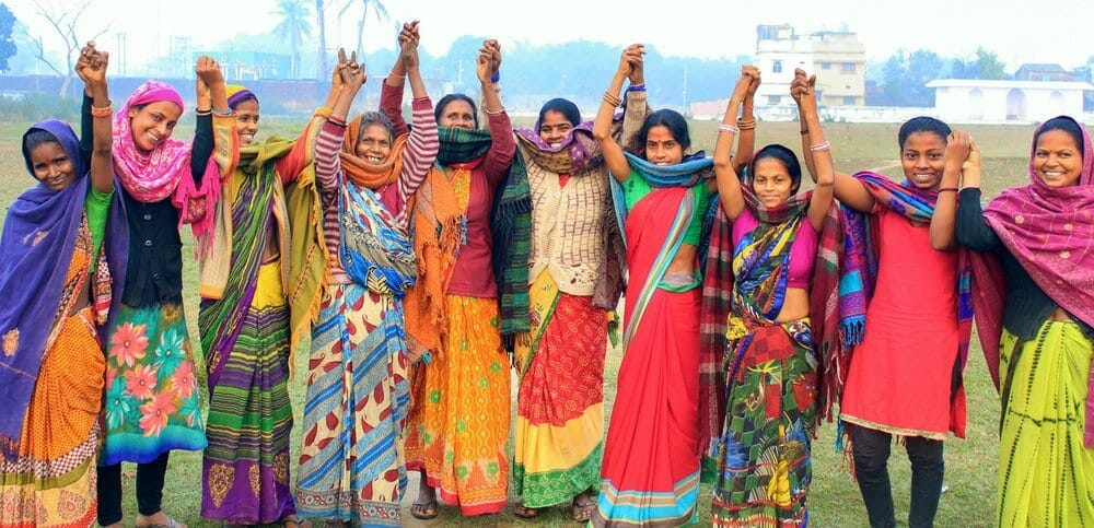 Women of Noni network in colorful closing celebrating with arms raised Network