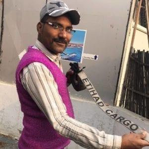 man in pink vest with belt