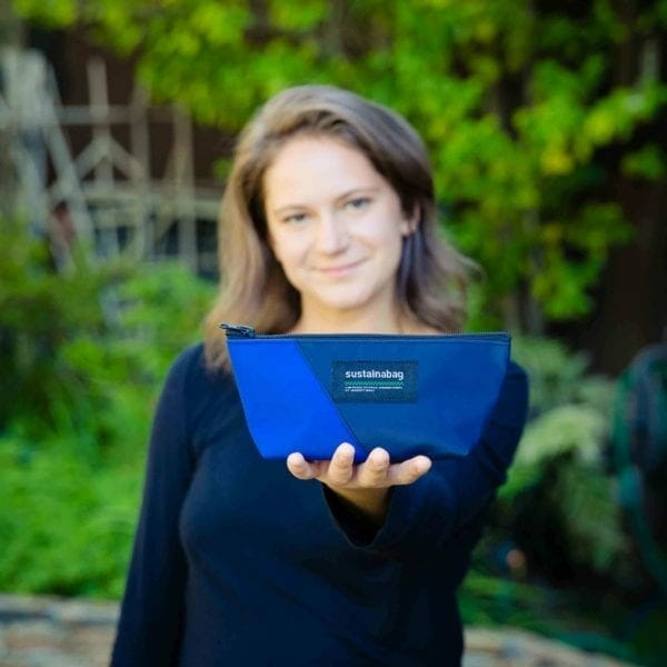 woman holding blue pencil case