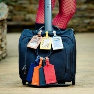 Luggage tags hanging on suitcase