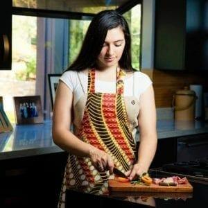 Model in apron at cutting board