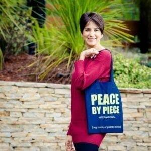 Model with bag Peace logo showing 2