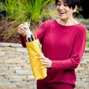 Model yellow wine holder removing bottle