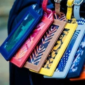 Row of multicolored luggage tags close up