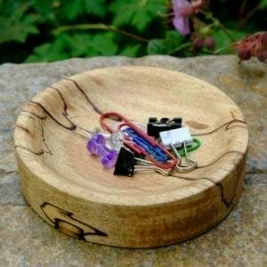 Wooden catch all bowl filled with paperclips