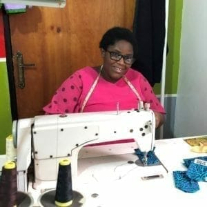 lady in pink dress at sew mach