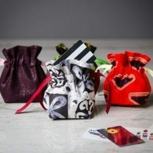 small pouches from bright fabrics with gift cards
