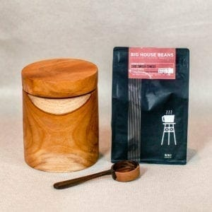 Fcoffee canister with scoop bag beside