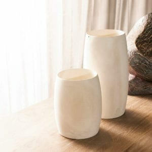 Small and medium vases up against window