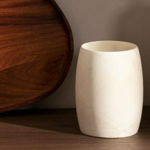 White vase with dark tray in background