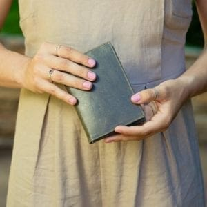Woman holding blue passport holder.jpg
