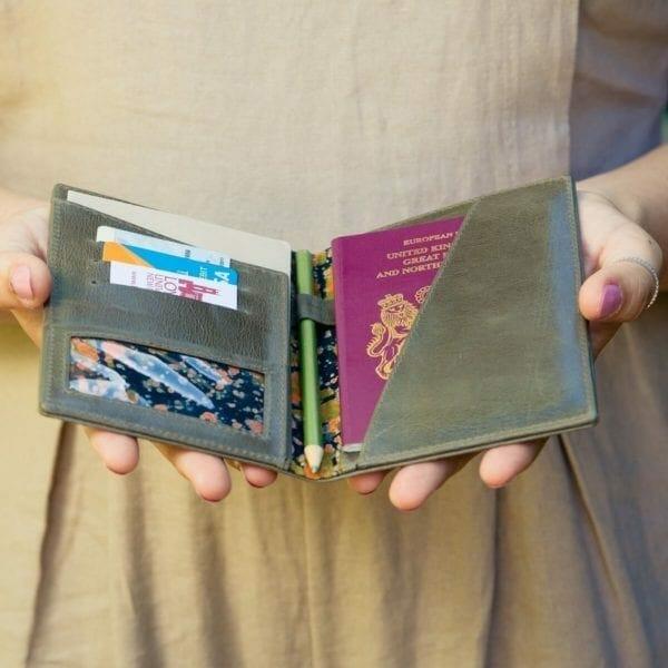 Woman holding open passport holder.jpg