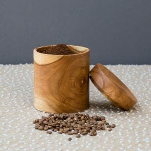 coffee canister with beans beside