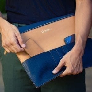 man pulling case out of blue and tan organizer
