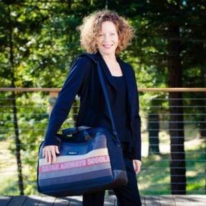 woman with weekender bag