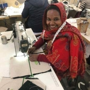 woman in headscarf at sewing mach