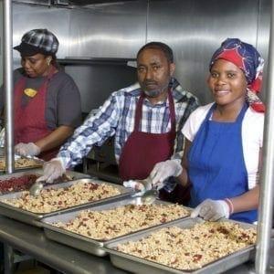 3 people making granola