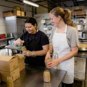 Women packing nut butter